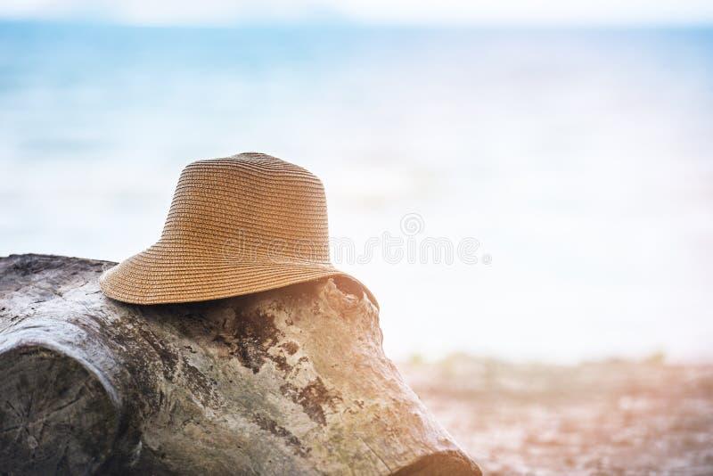 Hat summer Straw hat fasion on log at beach sea background. Hat summer / Straw hat fasion on log at beach sea background royalty free stock photography
