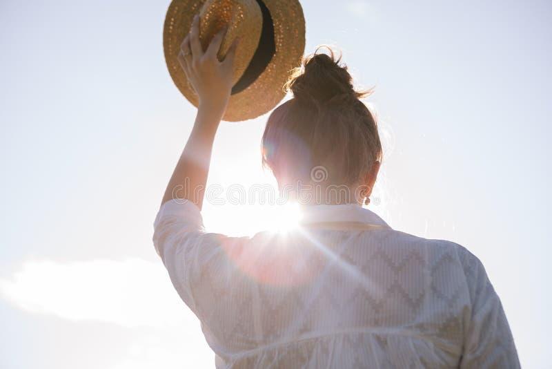 Good buy summer mood. Straw hat woamn back royalty free stock images