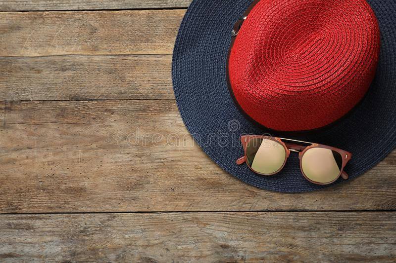 Hat with sunglasses and for text on wooden background, flat lay. Beach accessories. Hat with sunglasses and space for text on wooden background, flat lay. Beach stock images