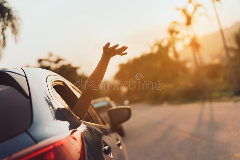 Hatchback Car travel driving road trip of woman summer vacation. In blue car at sunset,Girls happy traveling enjoy holidays and relaxation with friends together royalty free stock images