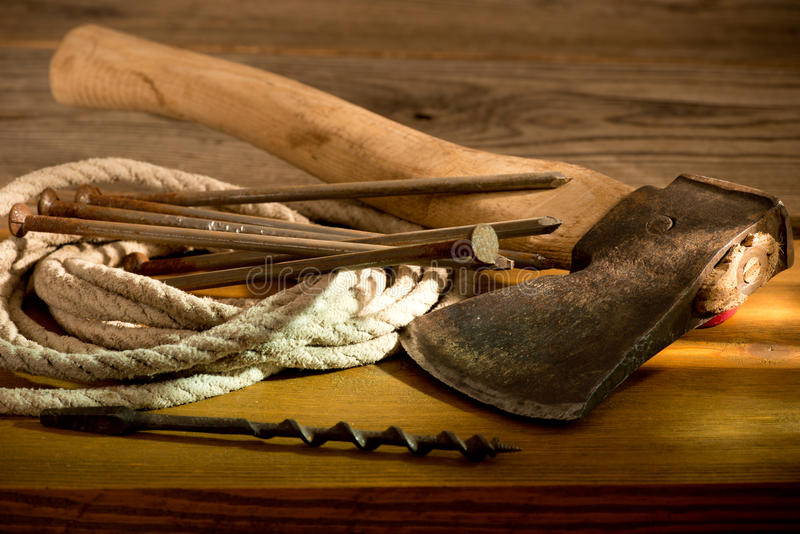 Hatchet. Still life with a hatchet and old tools stock images