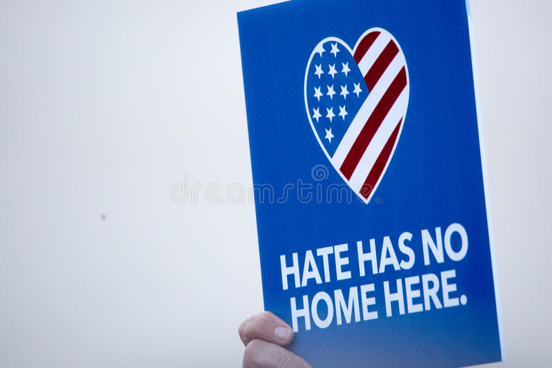 Hate Has No Home Here Sign at Anti-Trump Protest. Phoenix, Arizona - August 22, 2017: Anti-Trump protester demonstrates outside of the Phoenix Convention Center stock photography