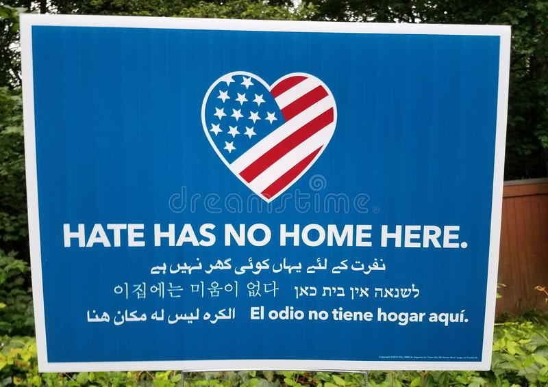 Hate has no home here. United States flag and heart. Multilingual stock photography