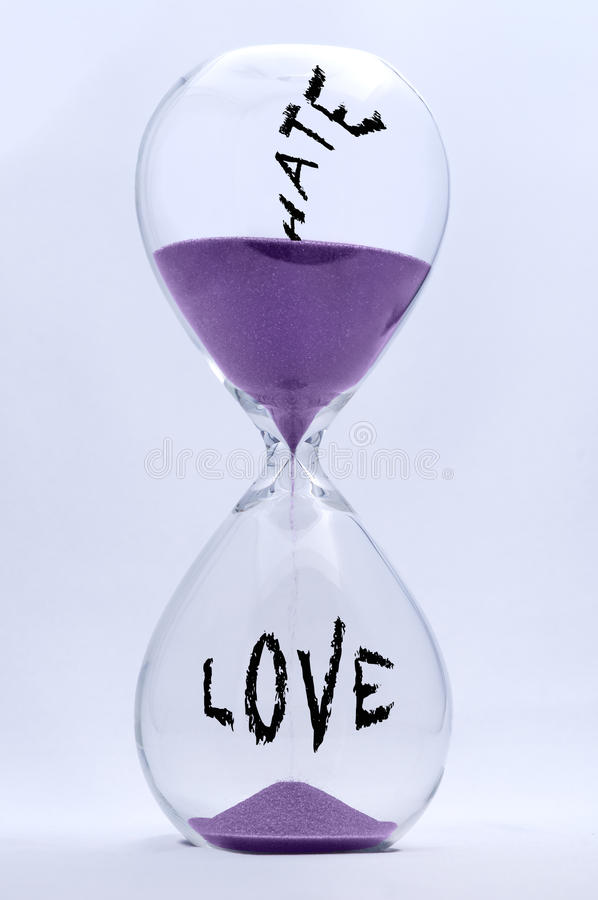 Hate and Love Hourglass. Hourglass with Hate turning into Love stock photography