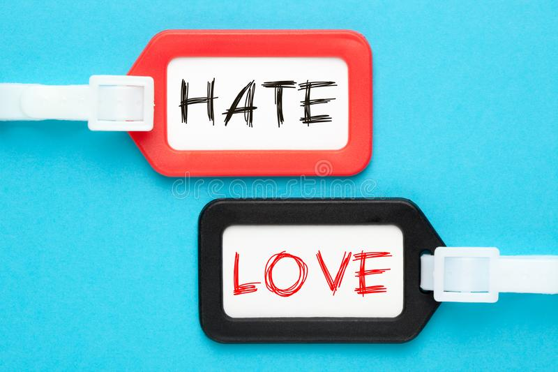 Hate vs Love Concept. Hate vs Love written on luggage tags on blue background. Business concept royalty free stock images