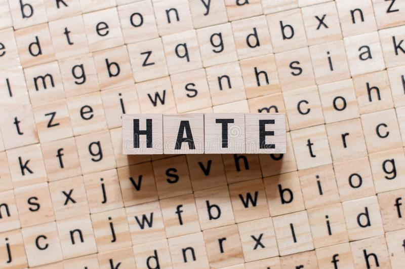 Hate word concept on cubes stock image