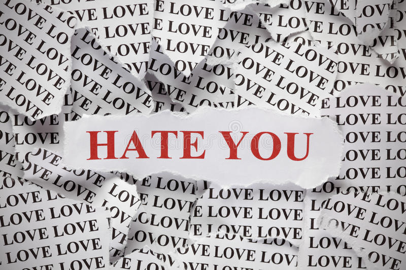 Hate you. Torn pieces of paper with the word Love and phrase  in red color. Close-up royalty free stock photo