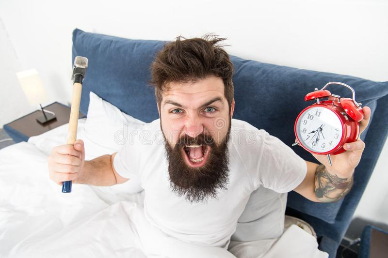 Hateful schedule. Best alarm clocks for people who hate mornings. Man angry hipster hate wake up early. Destructive. Energy. Hardest moment of day. It is royalty free stock photography