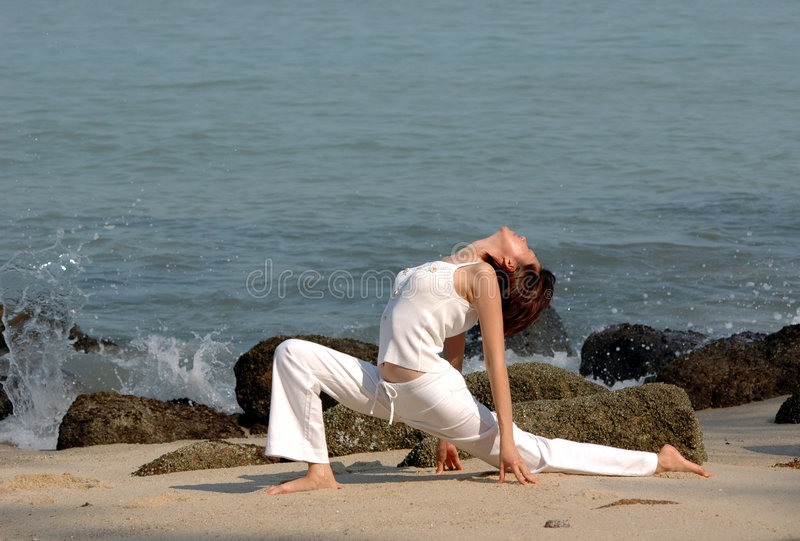 Hatha Yoga. By the beach