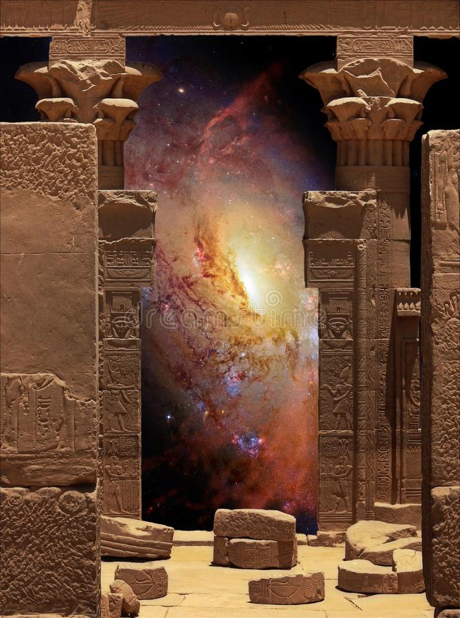Hathor Temple on Agilkia island and Galaxy M106 (Elements of thi royalty free stock photo