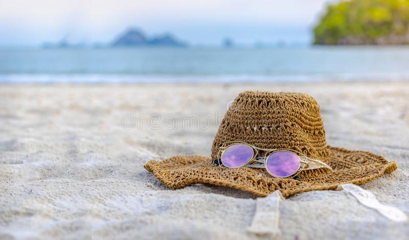 Hats and glasses are located on the beach, blue sea, during the day of relaxing or long holidays. Hats and glasses are located on  the beach, blue sea, during royalty free stock photos