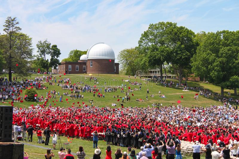 Hats are thrown in the air at outdoor Wesleyan University Graduation Middletown Conneticut USA circa May 2015. Red Hats are thrown in the air at outdoor Wesleyan stock images