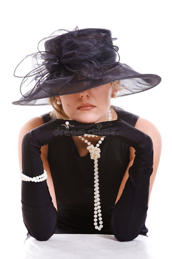 hatt som ser kvinnor arkivfoto