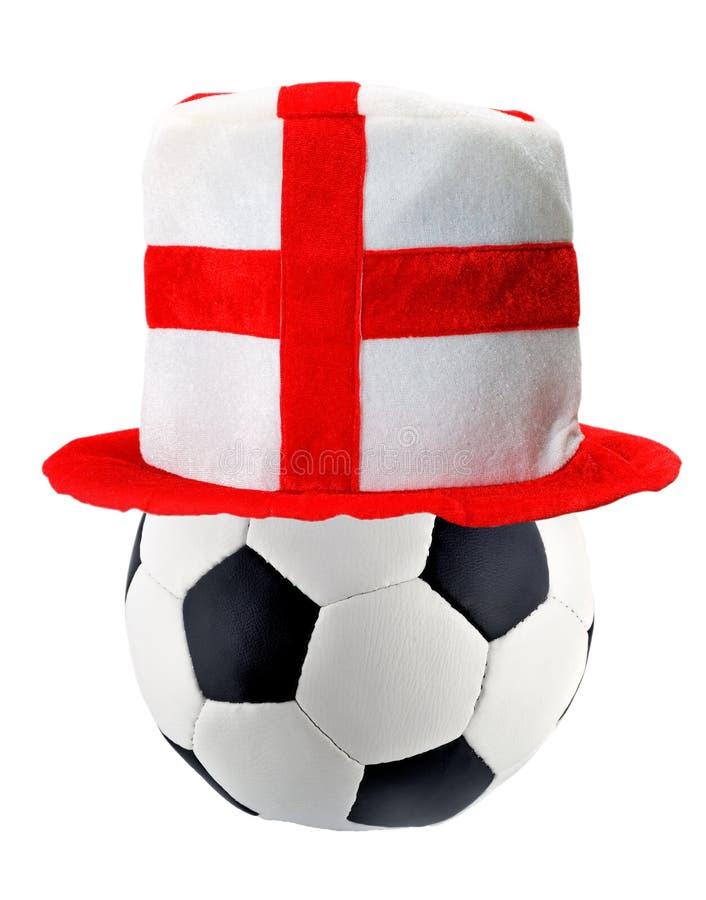 Hattengelska piskar in fotbollbollen fotografering för bildbyråer