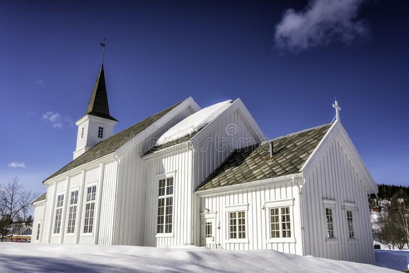 Hattfjelldal Church, Norway. Very sunny day, much snow, very deep blue sky and almost no clouds, side view royalty free stock photo