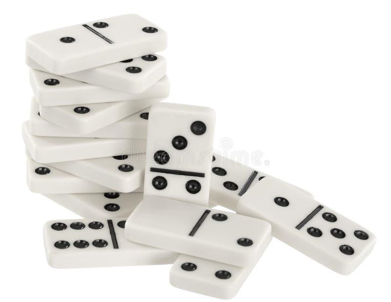 Haufen der Knochen von Dominos auf einem Weiß stockbilder