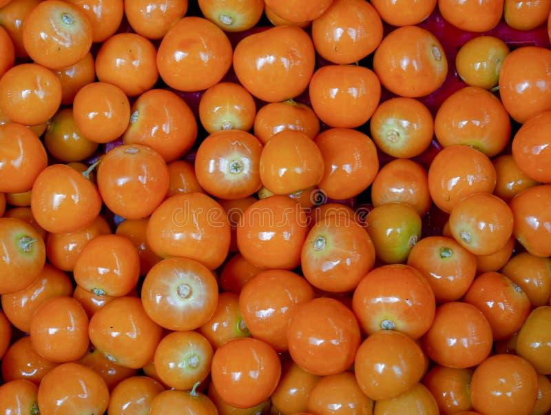 Haufen von goldenberries in einem Markt stockbilder