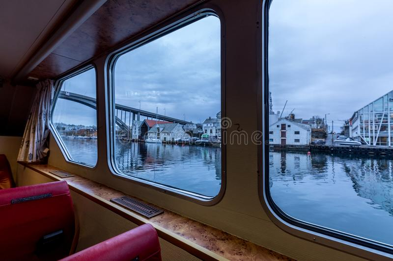 Haugesund, Norway, seen through the windows from inside the small ferry Rovaersfjord. View over Risoya and the Risoybroa bridge in Haugesund, Norway, seen stock photos