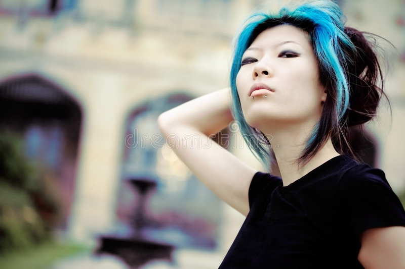 Haughty girl. Asian model in front of old building stock image
