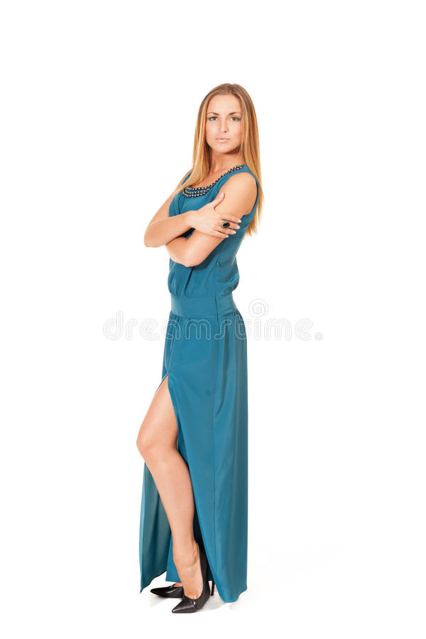 Haughty girl. In slit dress on isolated white stock photography