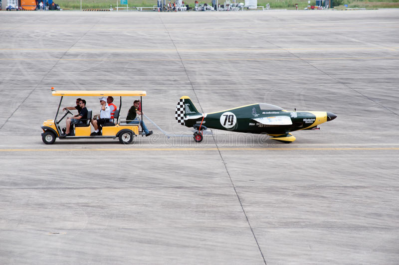 Haul aircraft hangar in Air race 1. Rayong,Thailand-November 19,2016 : Vehicle towing aircraft to the hall for wait a racing at the Air Race 1 in U-Tapao Rayong stock photography