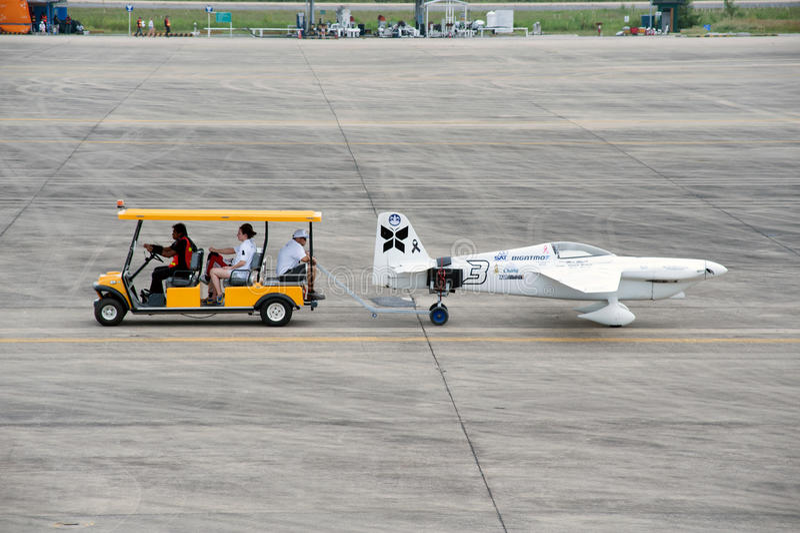 Haul aircraft hangar in Air race 1. Rayong,Thailand-November 19,2016 : Vehicle towing aircraft to the hall for wait a racing at the Air Race 1 in U-Tapao Rayong stock photos