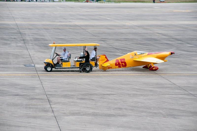 Haul aircraft hangar in Air race 1. Rayong,Thailand-November 19,2016 : Vehicle towing aircraft to the hall for wait a racing at the Air Race 1 in U-Tapao Rayong stock image