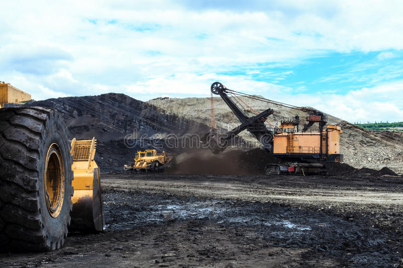 Haul Trucks being loaded with ore. stock photos
