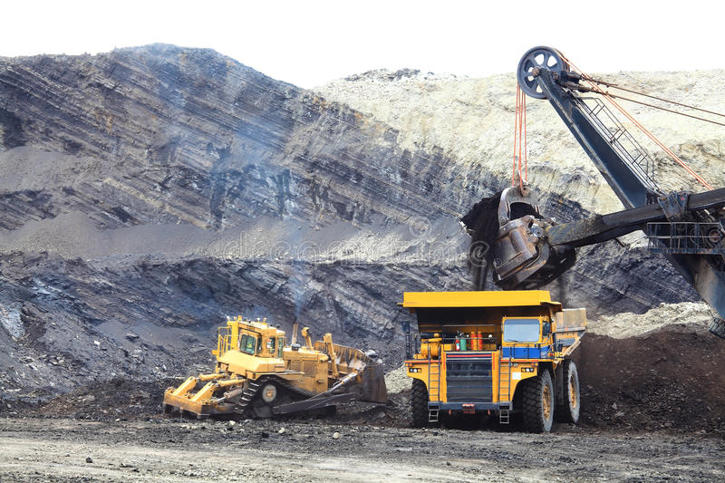 Haul Trucks being loaded with ore. royalty free stock photo