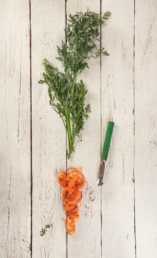 Haulm e pele da cenoura imagem de stock
