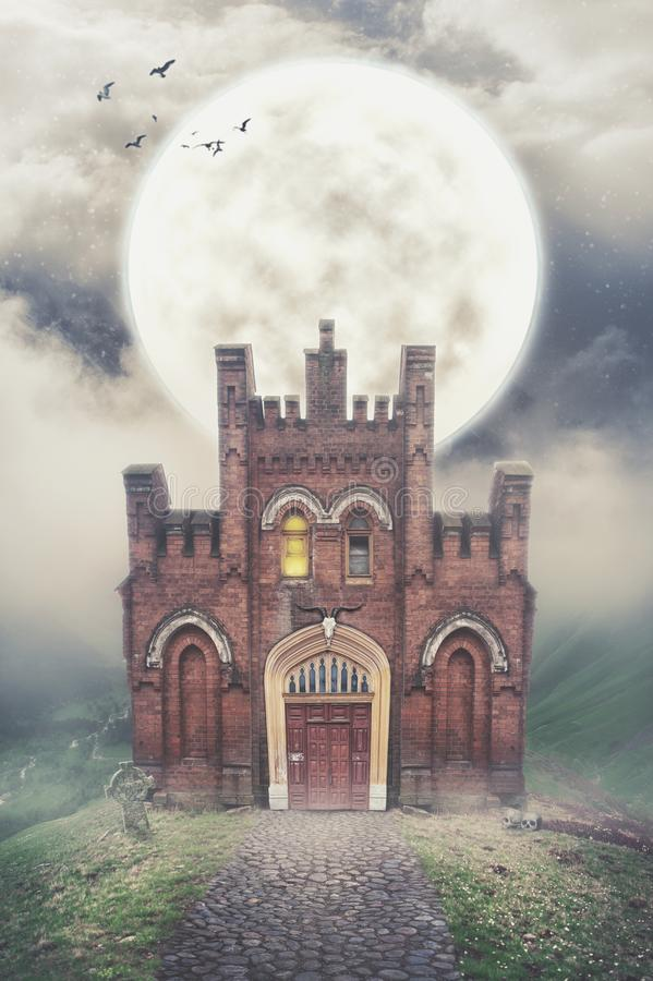 Haunted house on the hill and moon. Halloween dark scene royalty free stock photos