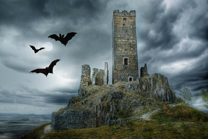 Haunted Castle, Halloween Landscape Scene. Haunted castle ruins with bats and moon on dramatic sky. Halloween landscape scene royalty free stock photography