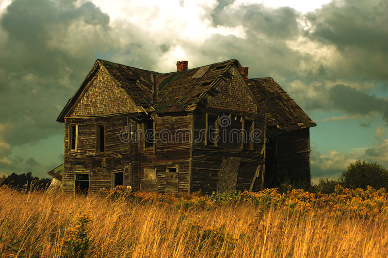 Haunted House. An old abandoned house which looks like a haunted house. A storm is looming in the background stock images