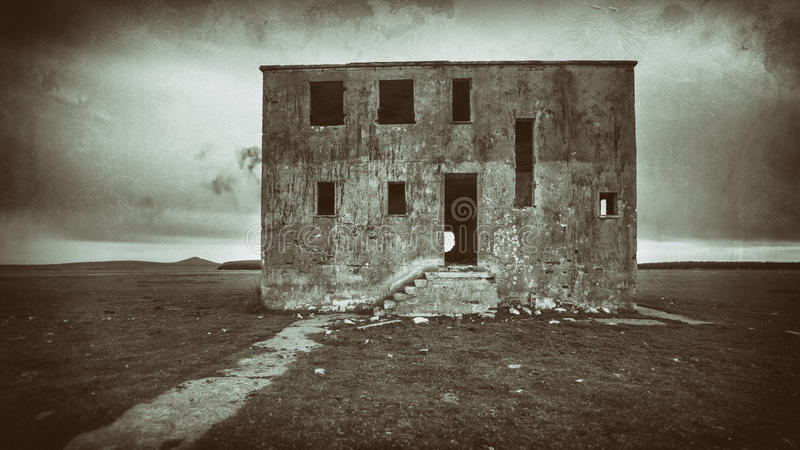 Haunted House. Aged photo of a bleak and scary haunted house stock photography