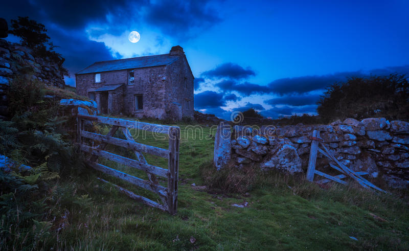 Haunted House. Creepy derelict haunted house under a full moon (Elements of this image furnished by NASA royalty free stock photo