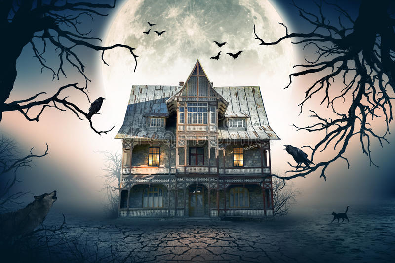 Haunted House with Crows and Spooky Atmosphere. stock photo