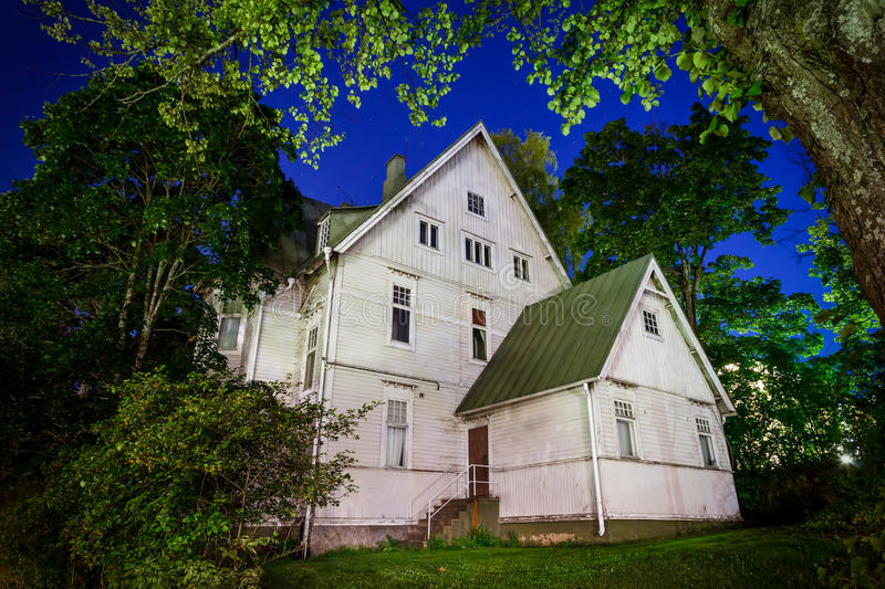 Haunted House. Spooky old haunted house at night in Hämeenlinna, Finland. Trees surrounding the house frames it nicely stock photos