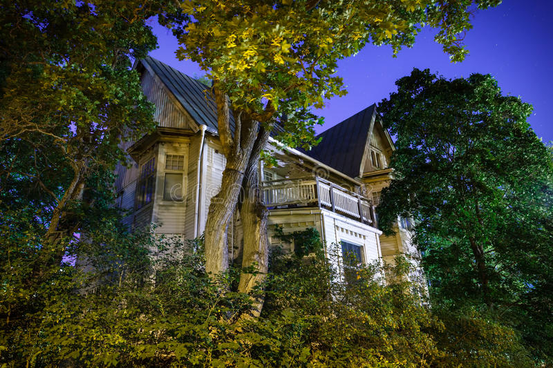 Haunted House. Spooky old haunted house at night in Hämeenlinna, Finland. Trees surrounding the house in the moonlight stock images
