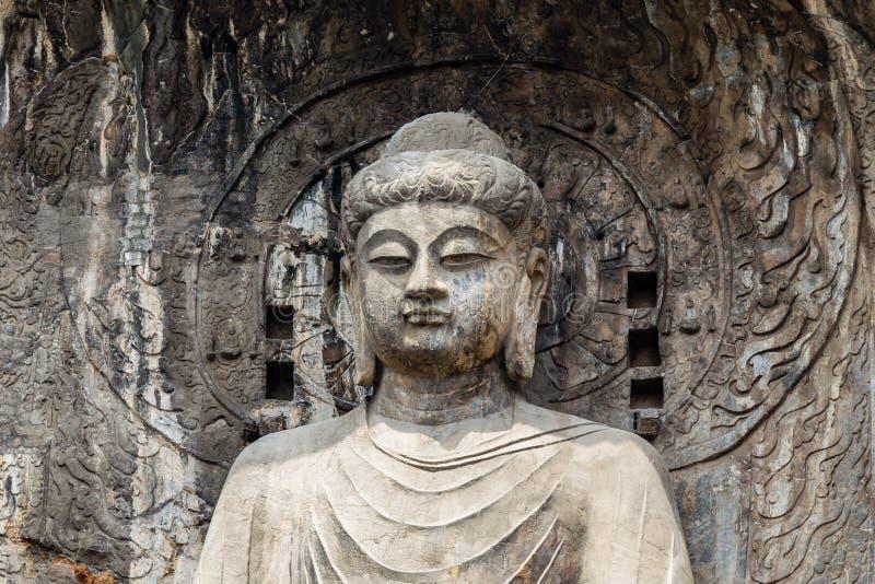 Haupt-Buddha-Statue in Fengxiangsi-Höhle, das Haupt in den Longmen-Grotten in Luoyang, Henan, China stockfotografie
