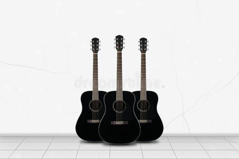 Hauptinnenraum - schwarze Gitarre drei vor weißer Wand stockfoto