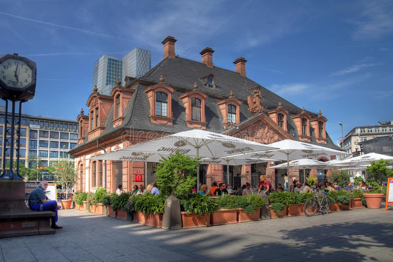 Hauptwache, Frankfurt, Germany. Frankfurt, Germany - June 3,2011: Hauptwache cafe populated by customers in summer. Hauptwache is former guard-house which today stock photo