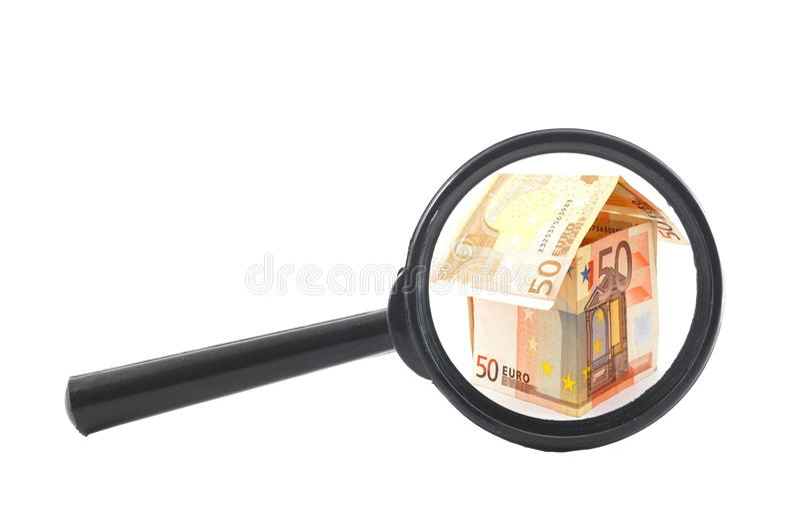 Haus des Geldes und des magnifyer lizenzfreies stockbild