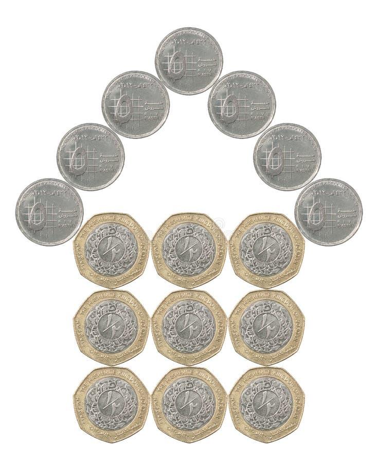 Haus gebaut von den Münzen lizenzfreies stockbild