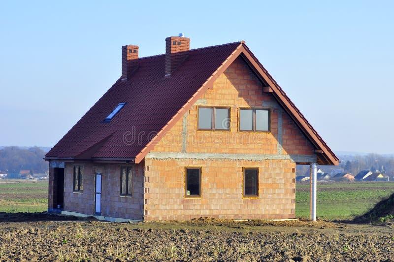 Haus im Bau - closed-in lizenzfreie stockfotografie