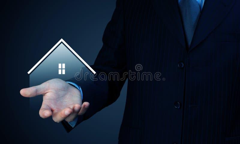 Haus im Rettungsring auf einem weißen Hintergrund stockbilder