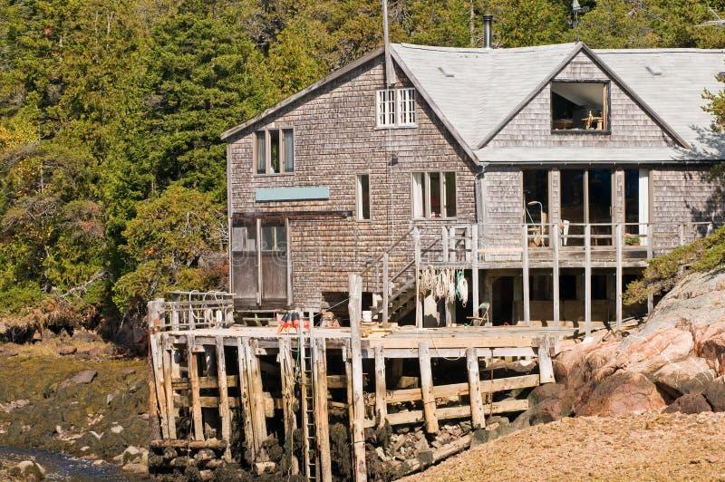 Haus und Dock des Fischers stockbild
