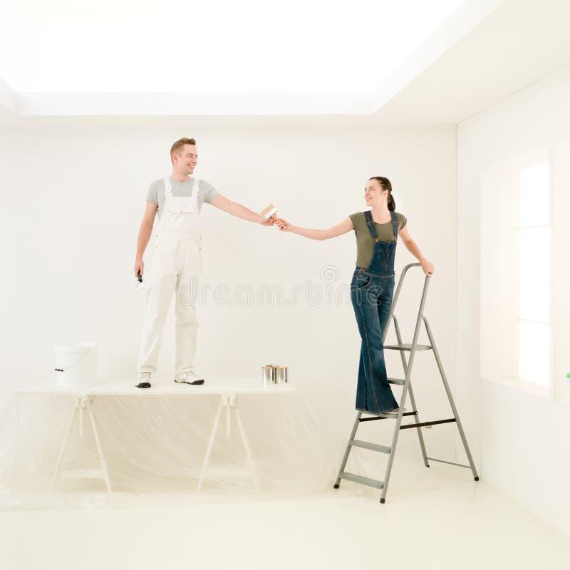 Hausarbeit verbindet Team stockbild