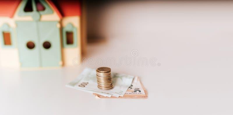 Haushypothekendarlehenkauf-verkaufspreisimmobilieninvestitions-Geldmengefoto stockbild