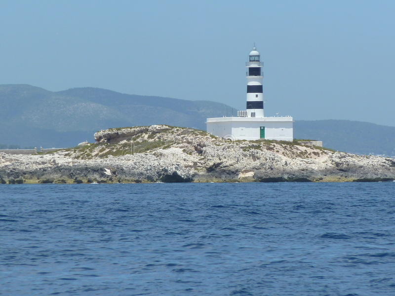 Hauslicht auf dem Meer lizenzfreies stockfoto