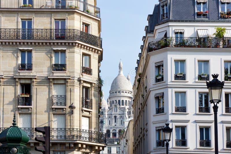 """Haussmannian building and Sacré-Cœur basilica. Haussmannian building and Sacré-CÅ""""ur basilica in Paris city stock photography"""